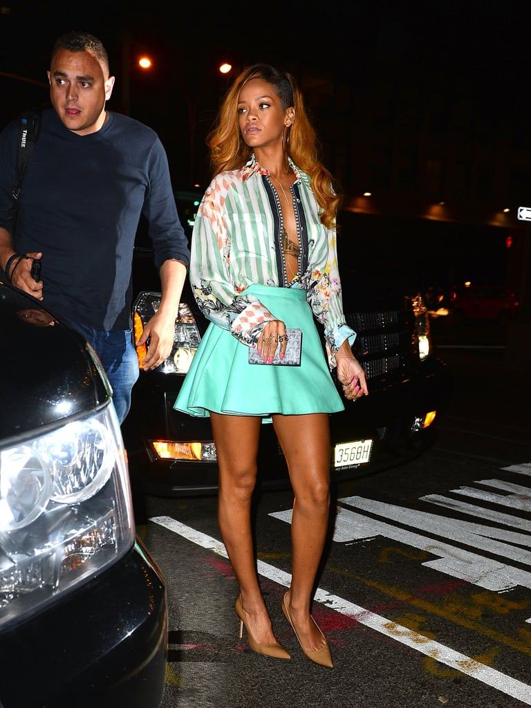 The Barbados princess showed her love for Balmain working a printed silk blouse, intentionally unbuttoned, and turquoise leather skater skirt while out in NYC in May 2013.
