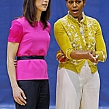 Michelle Obama talks with Samantha Cameron at an Olympics-themed event for school kids in connection to Michelle's Let's Move! campaign.