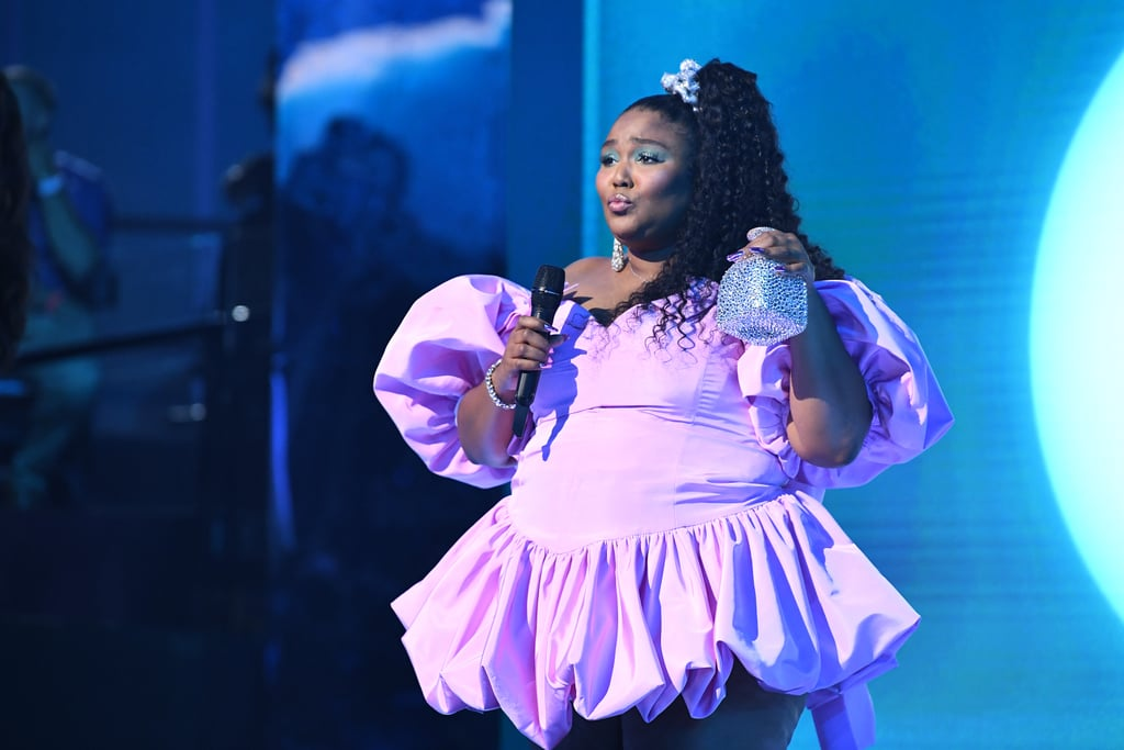 "Lizzo didn't wait until the afterparty to celebrate her MTV VMAs debut. During her performance of ""Truth Hurts"" and ""Good as Hell,"" the singer took a swig from a custom bedazzled bottle of Patron by Sparkyle Studio, which she continued to tote around throughout the evening.  While the bottle may have been empty during the performance, Lizzo revealed in an interview with Entertainment Tonight that it did indeed contain tequila when she later went to present an award. ""Here's the tea: I wasn't allowed to have a full bottle of tequila so we had one shot. I took the whole shot on accident right before my speech,"" she said. ""So, I was lit. Whatever I said, I don't remember."" Check out photos of the best accessory of the evening ahead.      Related:                                                                                                           Calling It: Lizzo's VMAs Red Carpet Strut Is the New Bend and Snap"