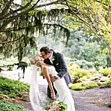 """""""I love this photo of Michelle and Ryan with the trees circling around them and the romantic kiss from the groom to the bride.  They had this embrace right after they saw each other for the first time on their wedding day."""" — Erin Johnson"""