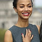 If you're going for a red hue on your nails, then take a style cue from Zoe Saldana and go for a matte finish with a matte top coat.