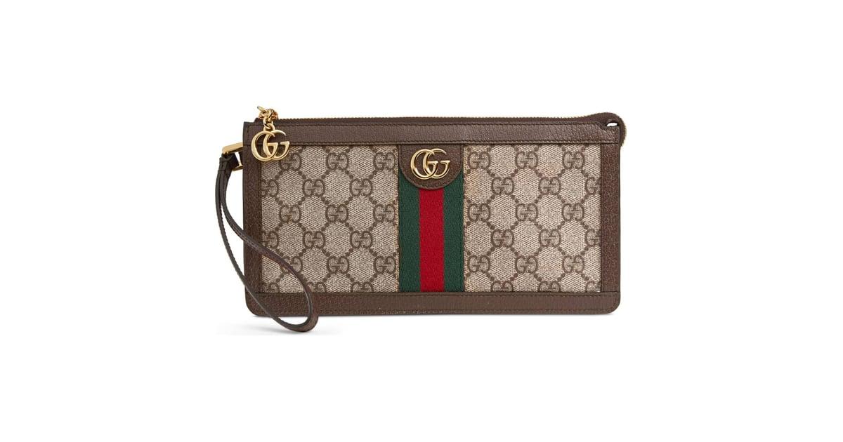 a031d6cc91123e Gucci GG Supreme Canvas Travel Wristlet | Angelina Jolie's Louis Vuitton  Wristlet 2019 | POPSUGAR Fashion Photo 14