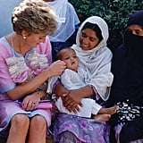 In September 1991, Diana adoringly stroked a baby's cheek while visiting a welfare centre in Noopur Shanan.