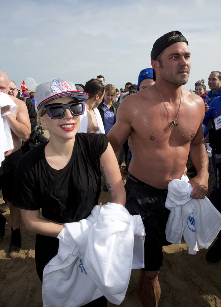 "Fresh off her earth-shattering Oscars performance, Lady Gaga and her other half, Taylor Kinney, participated in Chicago's Polar Plunge on Sunday. The couple, who got engaged in February 2015, jumped into the icy-cold waters at North Avenue Beach, along with NBC's Al Roker and Dylan Dreyer, to help support the athletes of the Special Olympics. At one point, Taylor even whipped his shirt off, flashing his buff physique and adding to his long list of superhot moments. Lady Gaga also uploaded a series of fun photos on Instagram, writing, ""We love the city of Chicago and the Polar Plunge for The Special Olympics. These men and women are brave and powerful. Me and Taylor love getting cold in your honor every year."" In case you don't remember, the pair partook in the charitable event back in 2015, when they showed off plenty of PDA while playing around in the frigid waters of Lake Michigan. Read on to see more of Lady Gaga and Taylor's latest adventure, and then see all of their sweetest moments."