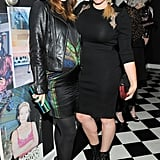 Pregnant Olivia Wilde put her bump on display while mingling with Amanda de Cadenet at W magazine's celebration on Thursday.