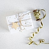 Constellations were a huge trend this Halloween — hello, galaxy jack-o'-lantern! — and they're just as hot for the Winter holidays. Etsy shoppers are making their presents out of this world with Golden Constellation Wrapping Paper ($6).