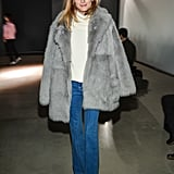 The style star kept it understated in flared jeans and a Tibi coat at the Tibi Fall show.
