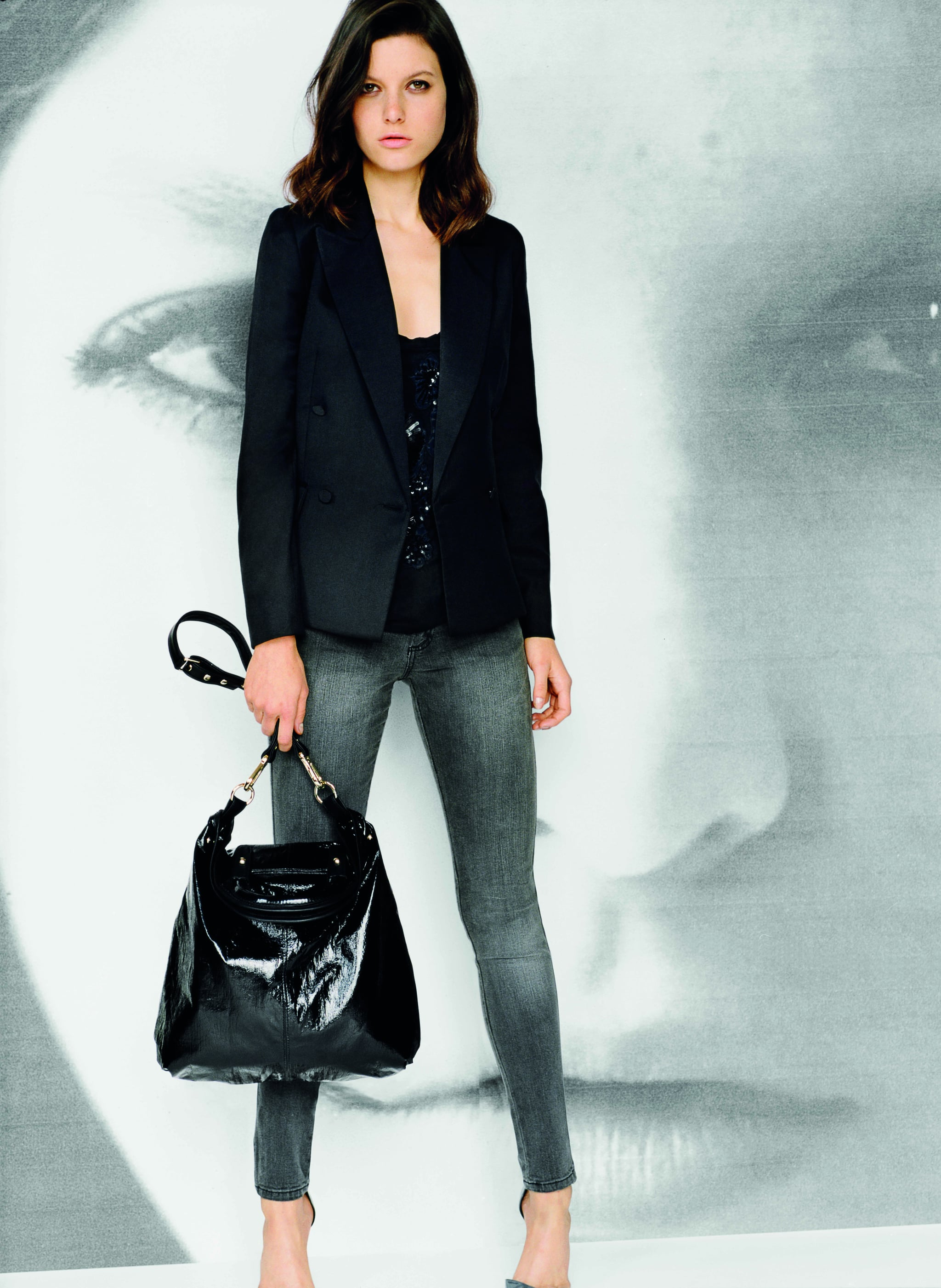 Small fitted double breasted jacket in black, $179 Embroidered T-shirt in black, $79 Ankle grazer jeans in grey denim, $99 PU tote bag in black, $99