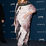 Drew Barrymore stood out in a pink-and-black graphic-print dress by Vivienne Westwood, which she adorned with an oversize pendant necklace and studded blue suede pumps.