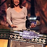 Katie Holmes shared a smile while accepting an award for her role in Disturbing Behavior at the MTV Movie Awards in June 1999.