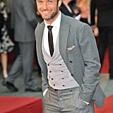 Jude Law flashed a smile on the red carpet.