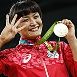 When a Japanese wrestler made history after she won a fourth consecutive gold medal.
