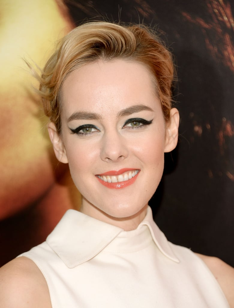 For the New York premiere, Jena Malone wore a retro cat-eye look with glossy orange lipstick and a simple updo.
