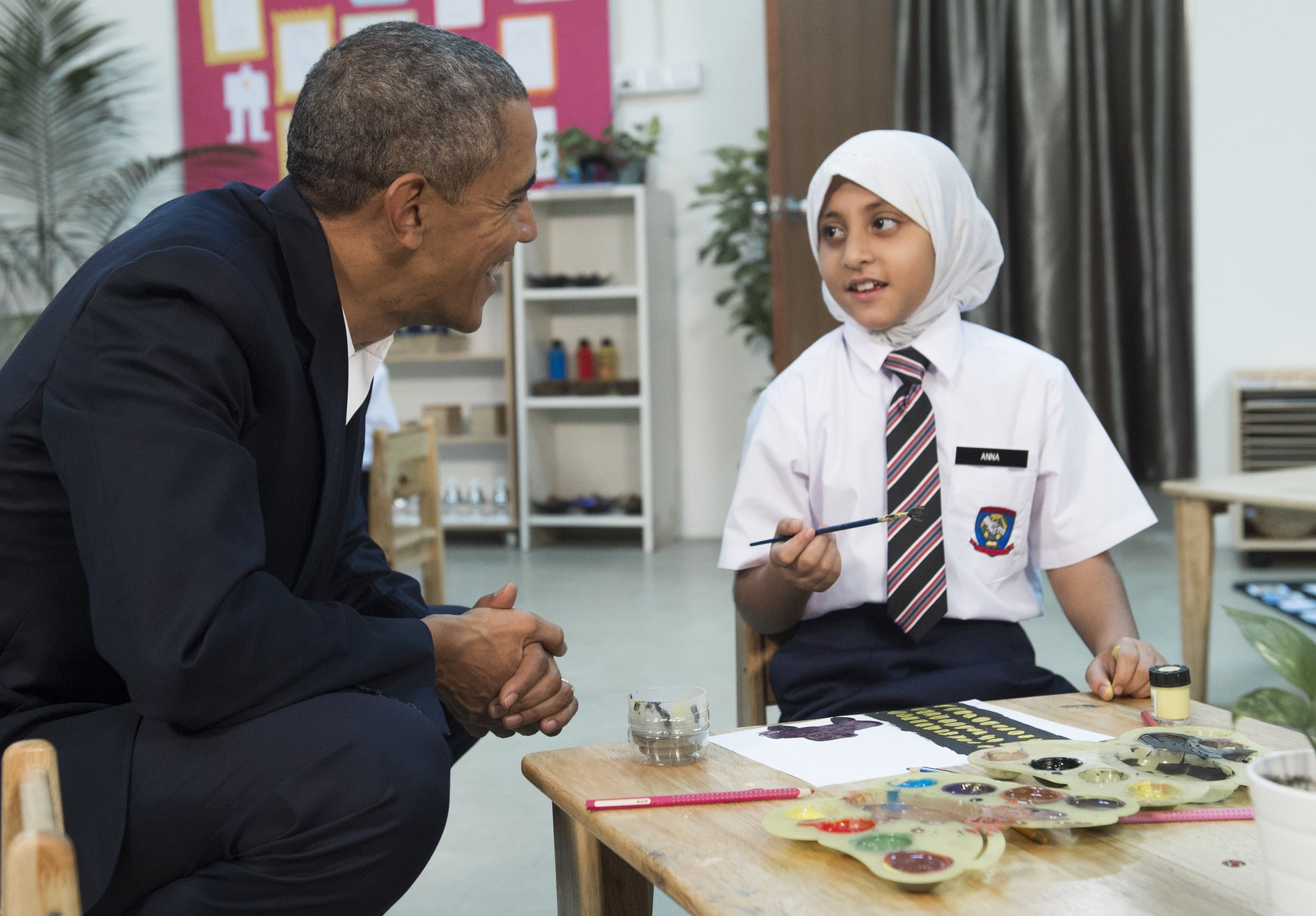 US President Barack Obama (L) speaks with children between the ages of seven and nine as he tours the Dignity for Children Foundation in Kuala Lumpur on November 21, 2015 on the sidelines of his participation in the Association of Southeast Asian Nations (ASEAN) Summit. The Foundation serves more than 1,000 poor and vulnerable children, many of them refugees, in a specialized learning environment to help develop children academically and socially to empower them to become productive members of society.  Obama and his counterparts from China, India, Japan and elsewhere are meeting in Kuala Lumpur for two days of talks hosted by the 10-country ASEAN.   AFP PHOTO / SAUL LOEB        (Photo credit should read SAUL LOEB/AFP/Getty Images)