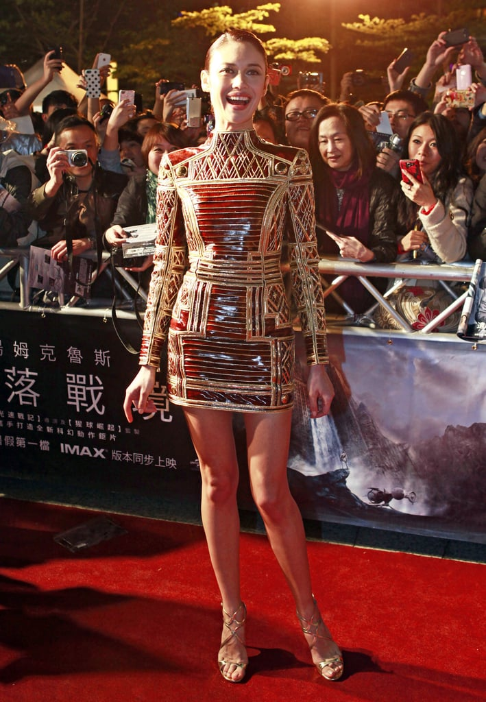 At the Taiwan premiere of Oblivion, Olga Kurylenko went structured and mini in a gold high-neck Balmain dress and gold strappy Jimmy Choo sandals.