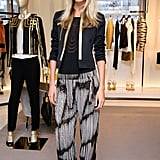 Poppy Delevingne proved she's the master of posh-meets-eclectic chic in flowy, printed pants and a fitted jacket at a London party for Derek Blasberg.