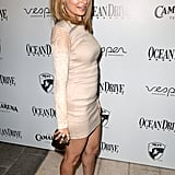 We love that Nicole Richie added a snake-embossed House of Harlow clutch to amp up the statement-power of a nude mini.