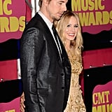 Kristen Bell posed with fiancé Dax Shepard at the CMT Music Awards in Nashville.