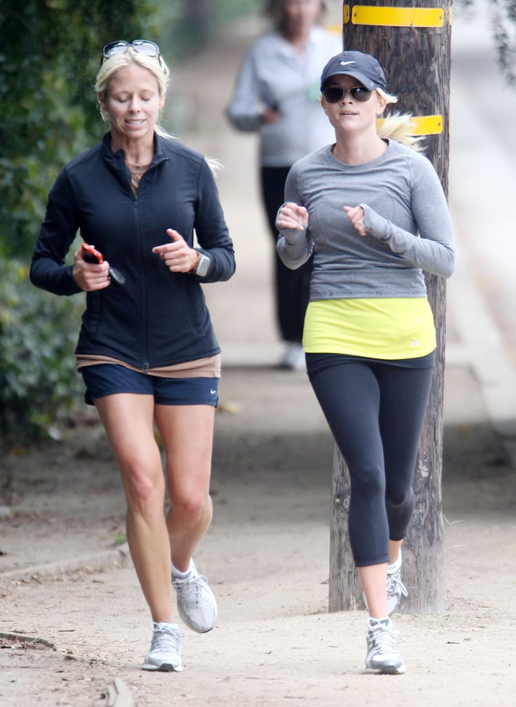 Reese Witherspoon jogs with a friend.