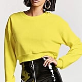 Add a yellow sweater ($18).