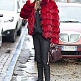 An apple-red fur added luxe and a little drama to this model off-duty uniform.