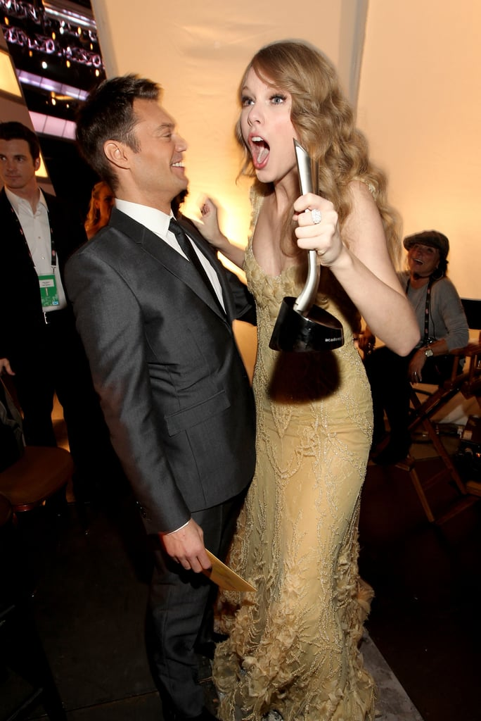 Taylor celebrated her award win with Ryan Seacrest at the ACMs in April 2011.