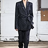 A model at the Tibi show pairing with a plaid suit.