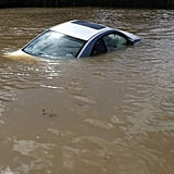 A car is nearly fully submerged by the water in Port Vincent, LA.