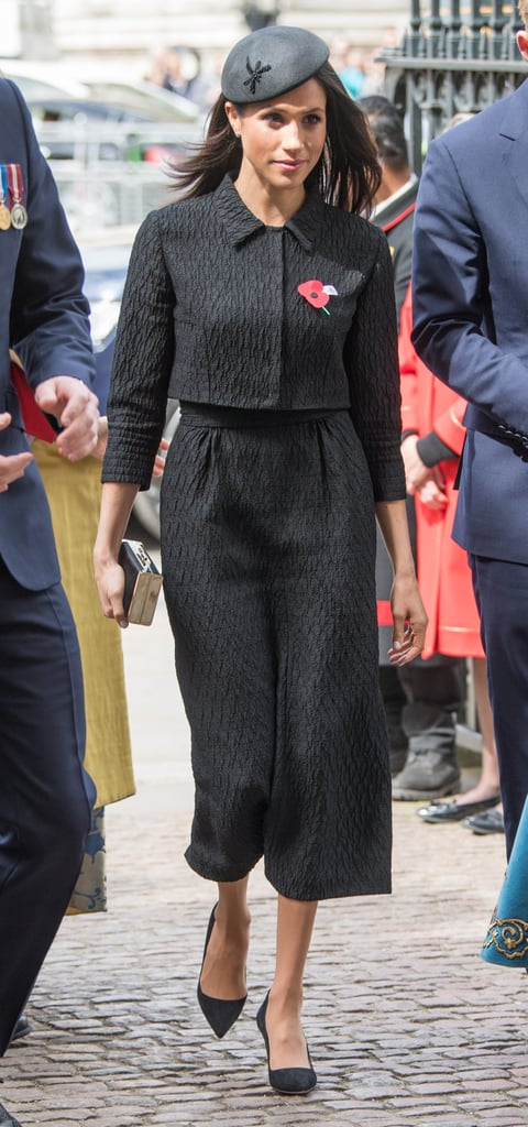 Meghan joined Prince Harry at the Anzac Day memorial in London in April 2018 wearing a custom skirt suit from Emilia Wickstead. She paired it with a Phillip Treacy fascinator, simple black pumps, and a clutch.