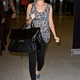 Nicole Richie showcased an easy way to wear black jeans — just add embellished slip-ons, a fun headscarf, and a printed top.
