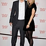 The Marley & Me leading lady hit the stage in 2009 working a refined LBD, opaque tights, and stacked oxford slingbacks. While we love Aniston's embossed statement shoes, we also noted Owen Wilson's black leather sneakers.