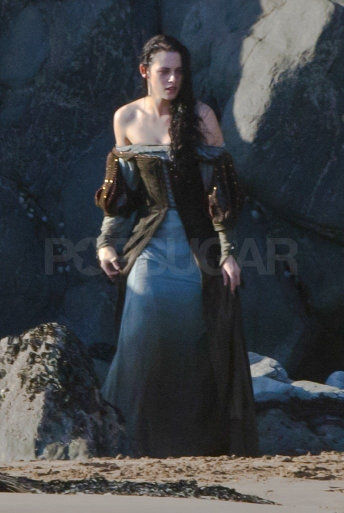 Kristen's dress and hair were drenched in water.