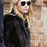 Ashley wore dark aviator sunglasses.