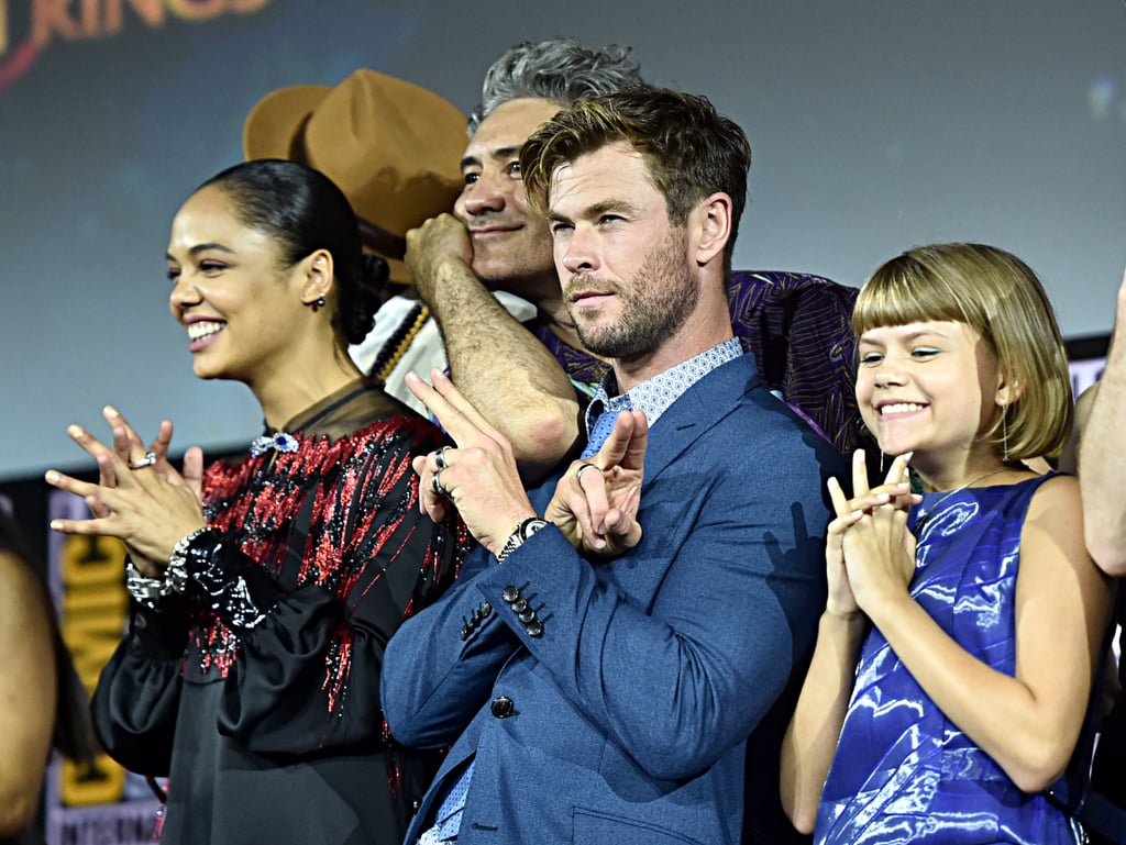Pictured: Tessa Thompson, Chris Hemsworth, and Lia McHugh at San Diego Comic-Con.