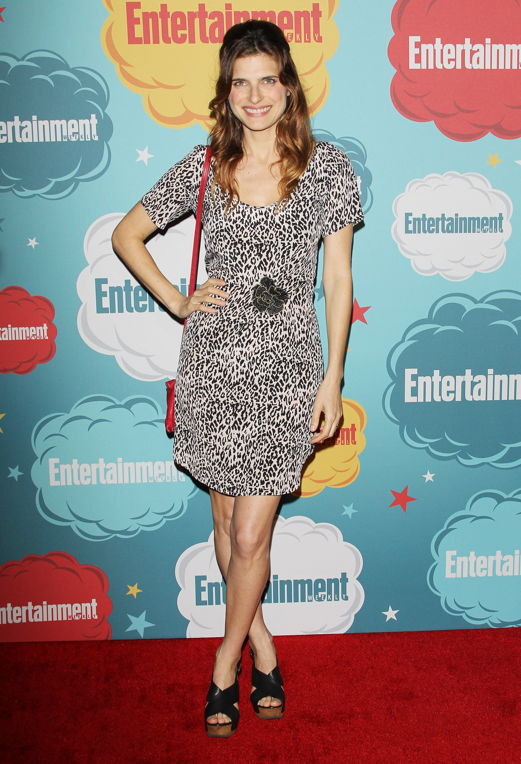 Lake Bell paired a printed dress with a red bag and black sandals at Entertainment Weekly's annual Comic-Con party.
