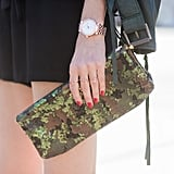 If you're a daytime sequin newbie, start with an eye-catching clutch you use to store the essentials.