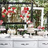 """""""Because Simone's sophisticated party theme was not your typical kiddie party, I wanted her dessert table to be equally chic. I kept the desserts classic in flavors and filled her table with gorgeous buttercream petal cookies and cupcakes in a variety of pink shades, and miniature cupcake truffle bites. The 'naked' cake topped with fresh flowers made the perfect centerpiece!"""" — Jenny Keller"""