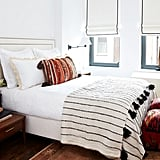 Make a bedroom more inviting with layers