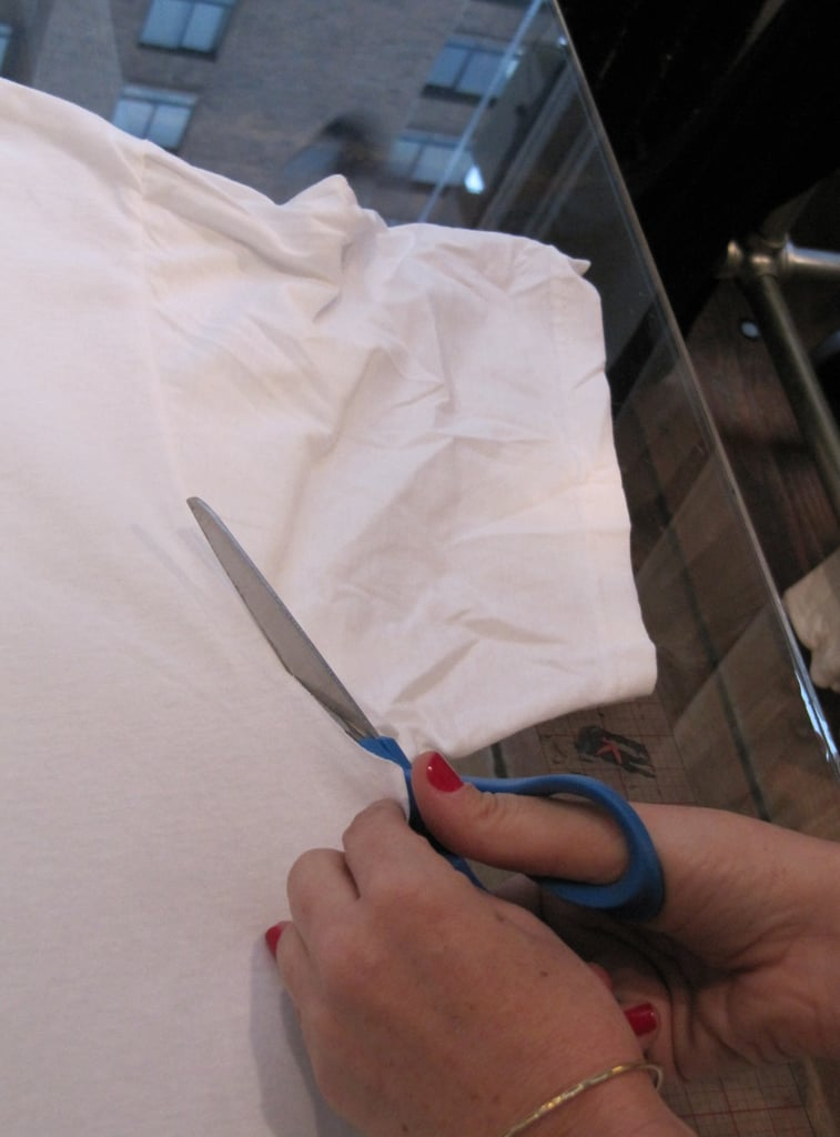 Cut off the sleeves at the seam.