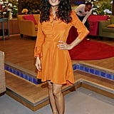 For her first promotion appearance on Univision's Despierta América in Miami on Monday, Salma Hayek made sure to stand out in a bright orange silk shirtdress, which she tempered with a pair of nude platform sandals.
