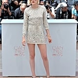 Kristen Stewart rocked a minidress and metallic heels at the photocall for Personal Shopper.