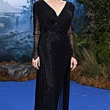 Wearing Atelier Versace at a private reception for Maleficent in 2014.