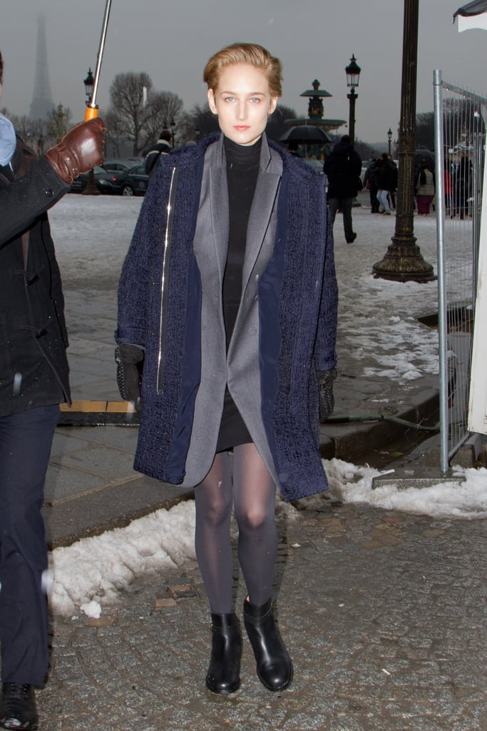 Leelee Sobieski layered up on muted grey and navy neutrals as she headed into the Dior Couture show.
