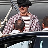 Johnny Depp smiled disembarking from the yacht.