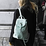 She gave us a glimpse of Spring with a mint-green backpack.