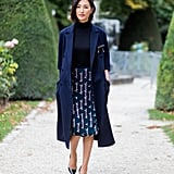 Just like how you can wear head-to-toe black, do head-to-toe navy. Street style star Nicole Warne makes this look easy by pairing together variations of the same color, plus a print to mix it up.