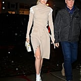 Gigi stepped out in a beige turtleneck wrap dress for New York Fashion Week. Asymmetrical button details added a special touch to the look, and the model rocked a pair of Diane von Furstenberg boots. She toted her go-to small bag, Stalvey, and a pair of white cat-eye sunglasses.