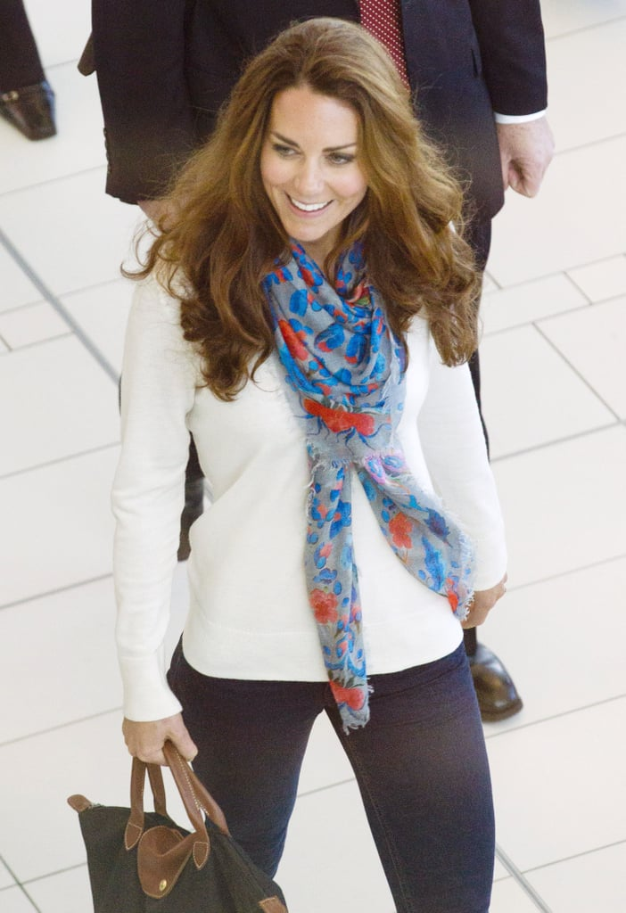 She accessorised with a Temperly Lotus Leopard Print Scarf.