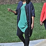 Michelle topped her green tunic and jeans with a zip-front anorak-style jacket, adding to the cool, casual effect.