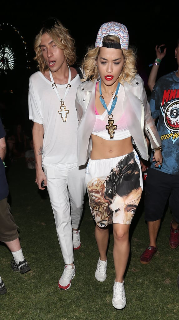 Rita Ora showed off her midriff in a funky white ensemble, complete with a backwards cap, at Coachella.